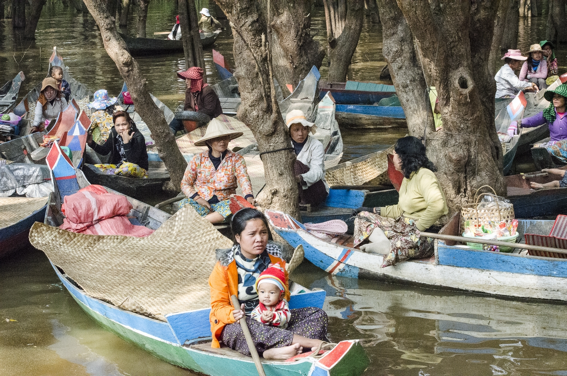 Financially-struggling-women-and-children-offering-tourists-rides-in-Cambodia-near-Tonal-Sap-Lake-JB-1-Place-by-Debbie-Bergvall-CC