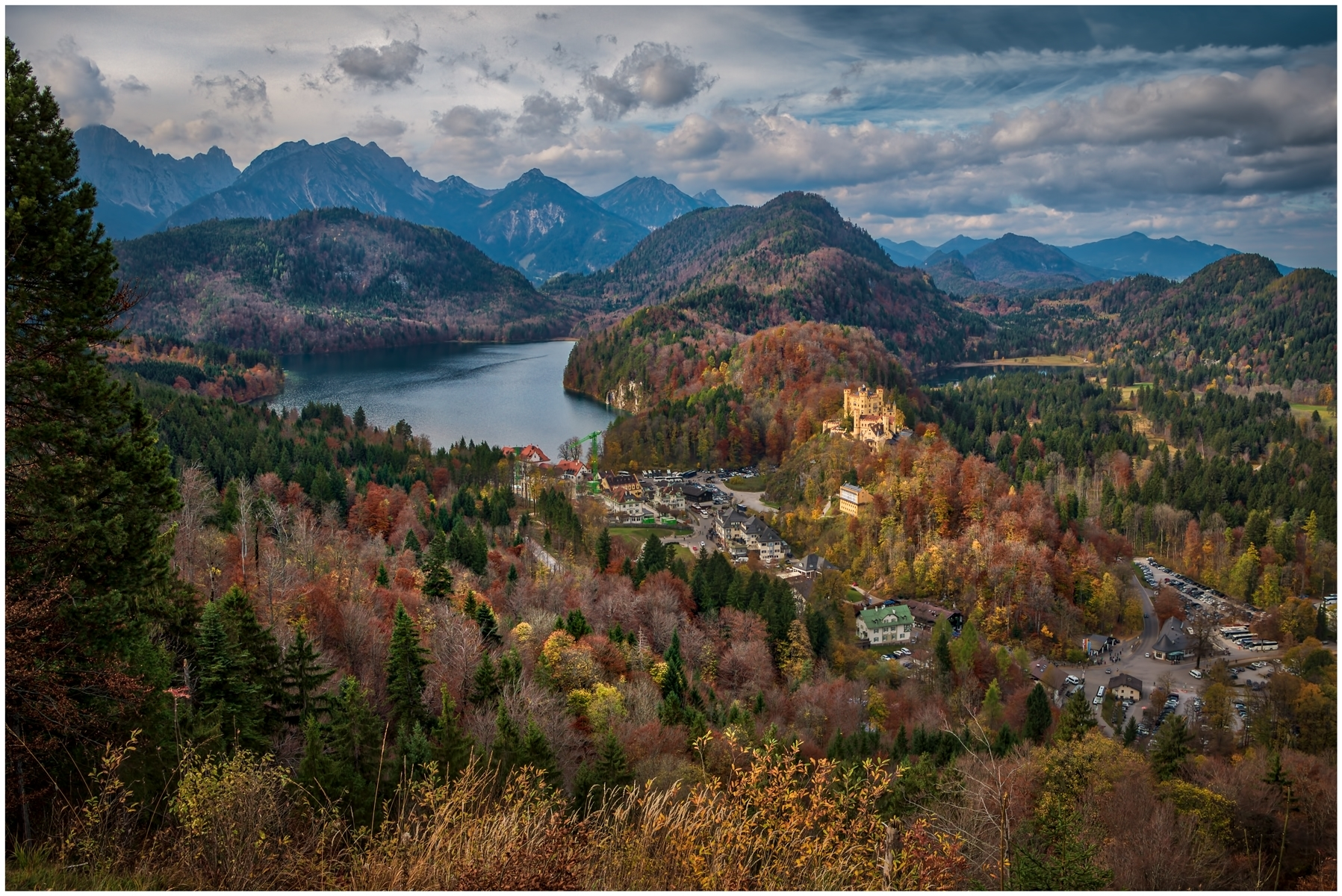 Germanys-Hohenschwangau-Castle-Lake-Alpsee-and-the-Austrian-Alps-in-the-distance-PA-1-Place-by-Barry-Zupan-LV