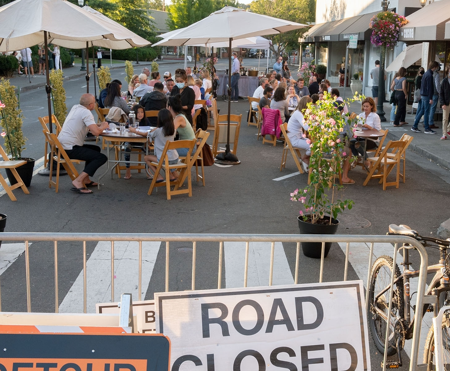 Covid-19-Marin-3-In-mid-July-restaurants-learned-how-to-safely-re-open-to-the-public-by-setting-tables-in-streets-and-parking-lots-JM-Place-by-Bill-Sumits-MR