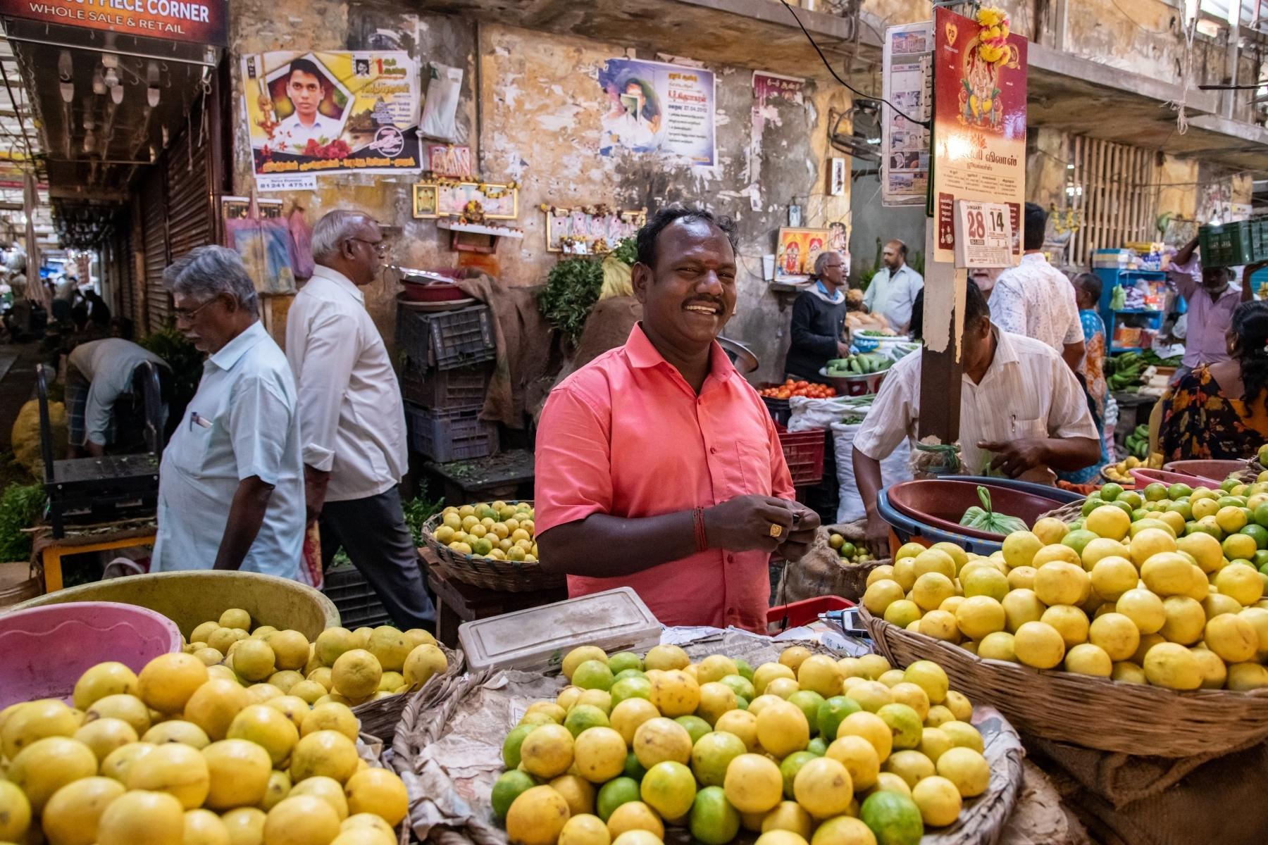 Food-Vendor-selling-lemons-at-the-busy-Pondy-Food-Market-Pondicherry-India.-January-2020.-TM-0-Place-by-Carol-Thomas-BK