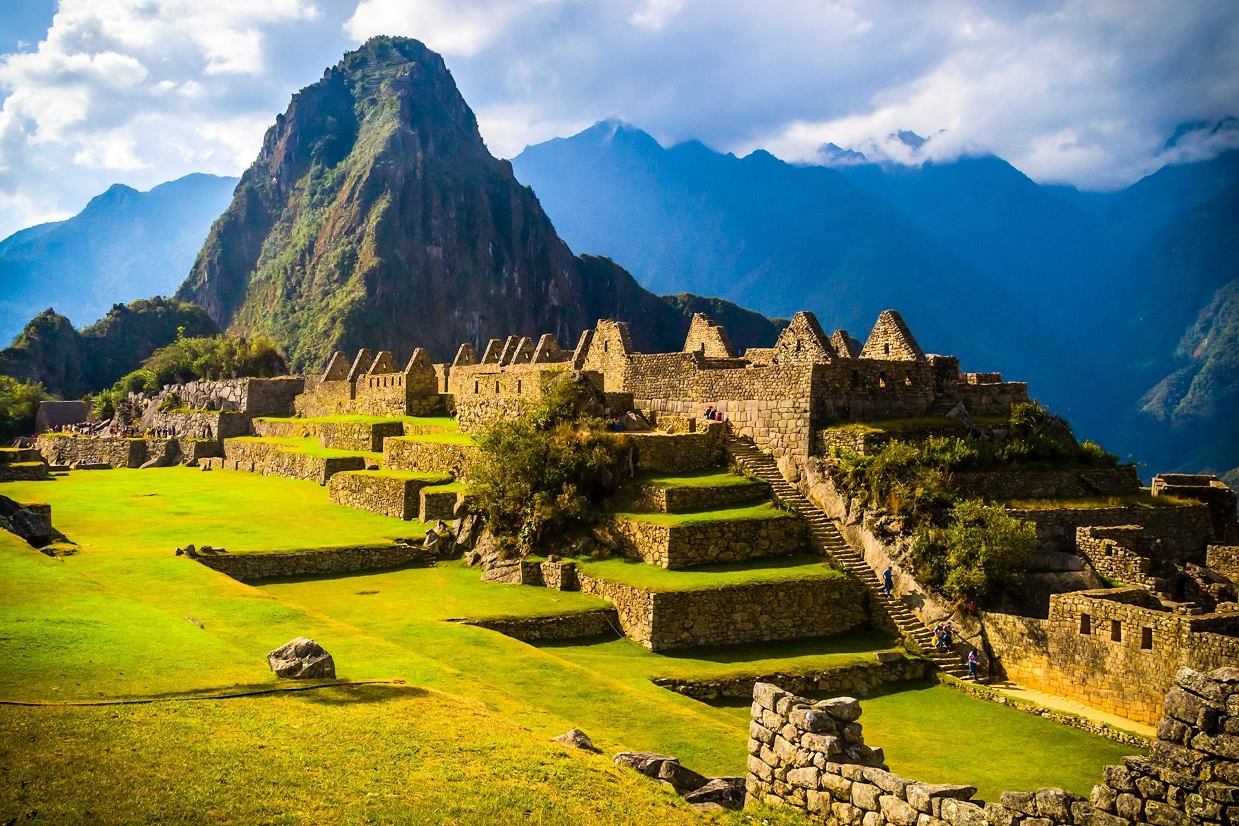 "Huayna-Picchu-Central-Plaza-at-Machu-Picchu-Huayna-Picchu-""young-peak""-in-Quechua-looms-865-feet-above-the-Central-Plaza-of-Machu-Picchu-TB-1-Place-by-Joel-David-Brown-SR"