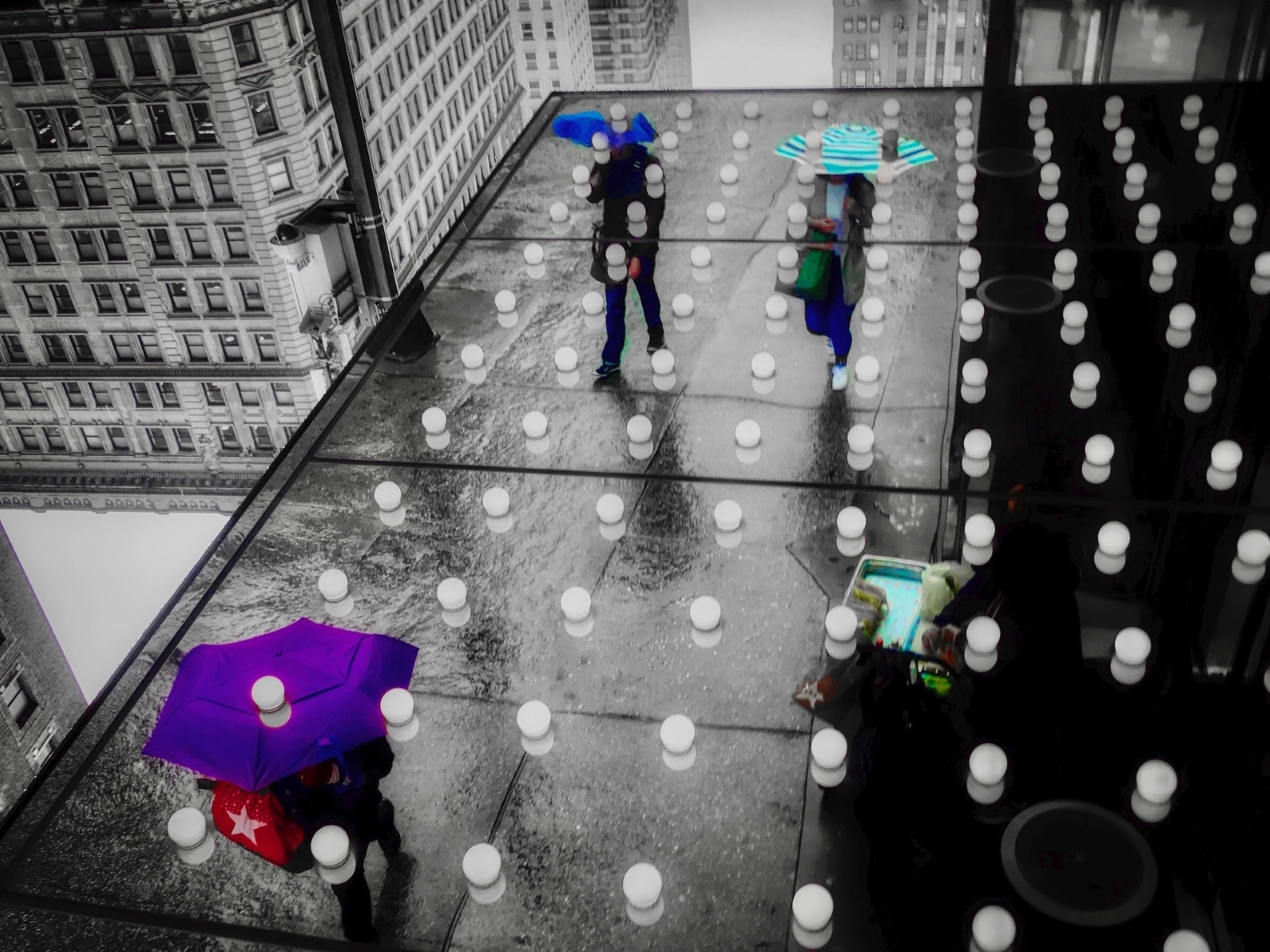 New-York-City_-Rainy-Afternoon-reflected-in-the-underside-of-the-canopy-at-Macys-Herald-Square.-CB-1-Place-by-Bob-Levy-MR