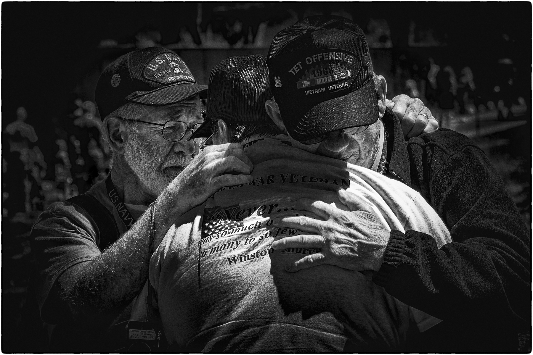 'Three veterans sharing memories of lost friends at the Vietnam Wall, Washington, D.C.' (JM Best in Show) by Ron Elkind - MR