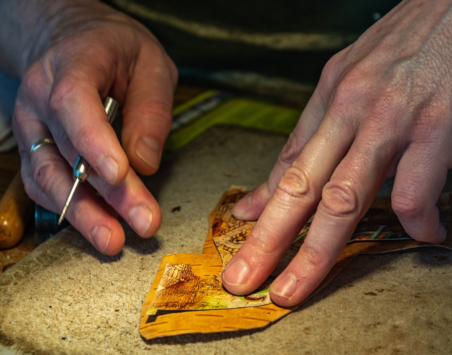 'Artisan's hands working with Birchbark, Mantrogy Russia' (PI 1 Place) by Robert Adler - RO