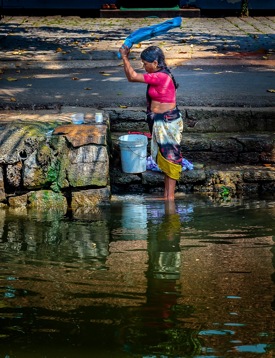 'Sri Lankan Woman Beats and Washes her Clothes on a Stone at the River's Edge.' (TM 1 Place) by Susan Stanger - LV