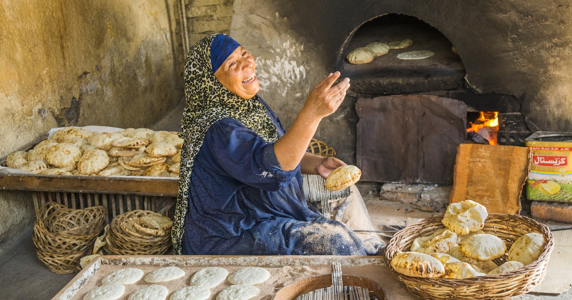 The-chapati-baker-greets-her-visitors-at-her-oven-at-a-village-near-Luxor-Egypt.-After-the-military-coup-Egypts-tourism-industry-collapsed.-TB-Best-in-Show-by-Fran-Mueller-MR